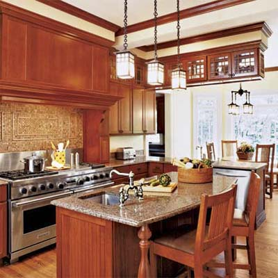 craftsman kitchen with pendant lighting marble counters and wood paneling
