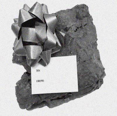 a lump of coal with a bow and gift tag on it