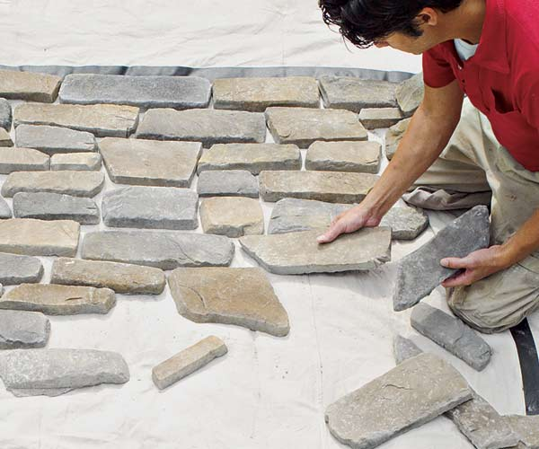 all about stone veneer installation tip lay out stone design on ground before installation