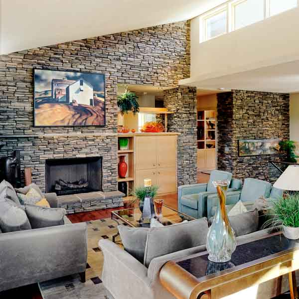 all about stone veneer stone living area with high ceilings, stone wall