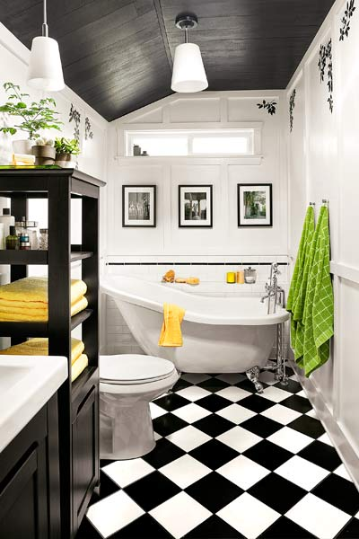guest bath after redo with black and white tile, soaking tub, white paneled walls