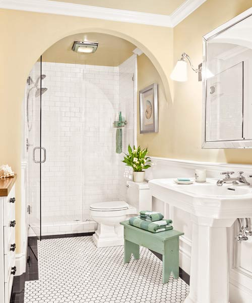 windowless, light-filled guest bath with wall arch after remodel
