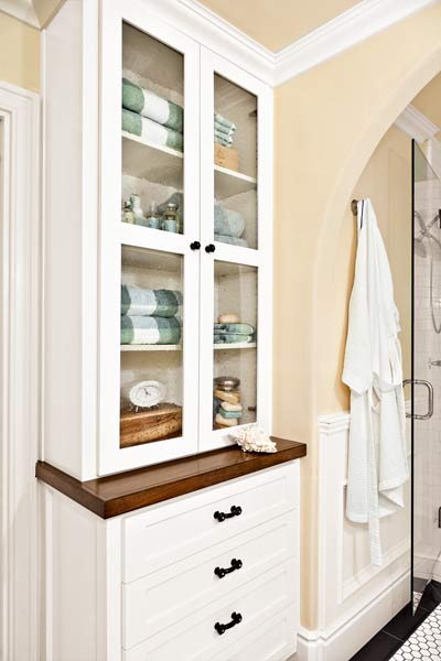 windowless, well-lit guest bathroom with built-in hutch after remodel