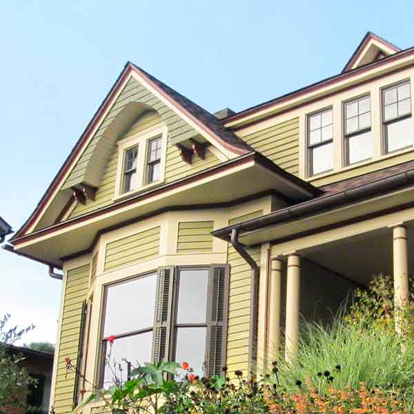 curb appeal boost on budget queen anne style home with multicolor scheme