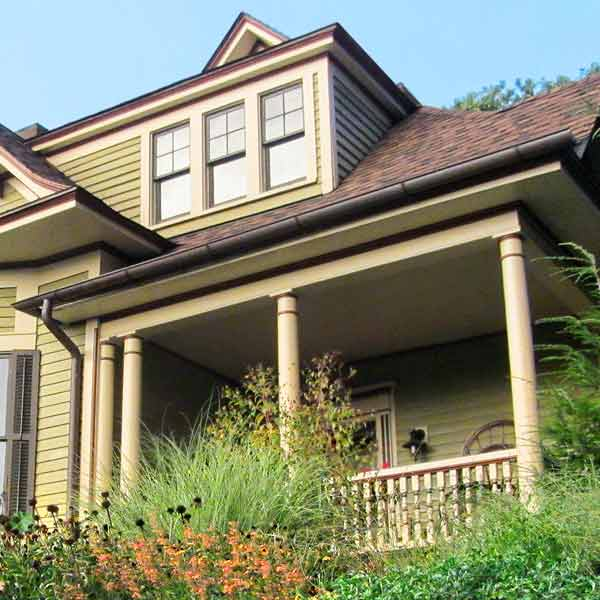 curb appeal boost on budget queen anne style home with copper half-round gutters, rain barrel