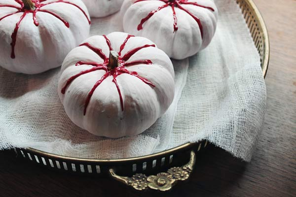 pumpkins painted with red puffy paint for blood, painted pumkin carving alternative