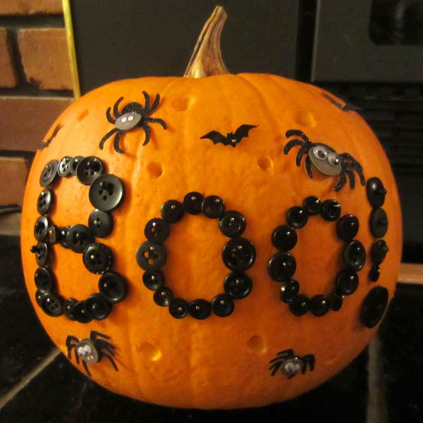 pumpkin decorated with buttons, painted pumkin carving alternative