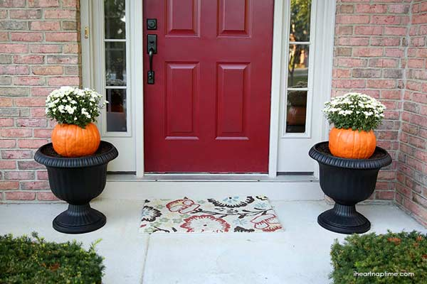 fake pumpkins used as flower planters, painted pumkin carving alternative