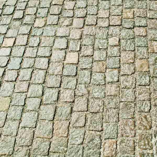 brick driveway with liquid pavement sealer