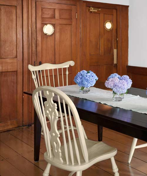 whole house remodel cape cod old restaurant house dining room with portholes in swinging doors