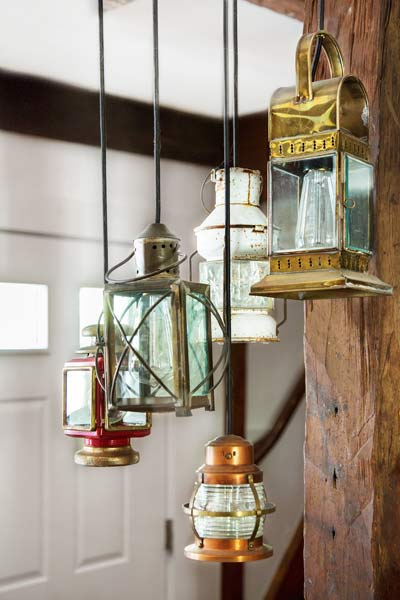 whole house remodel cape cod old restaurant nautical style electric lights hanging above old bar