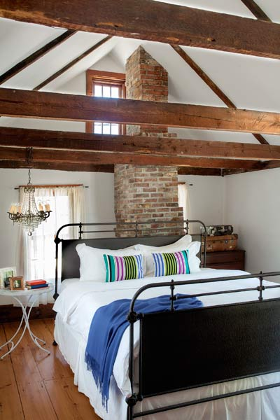 whole house remodel cape cod old restaurant master bedroom with ceiling beams and rafters, chimney extension