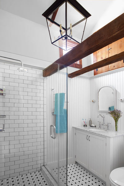 whole house remodel cape cod old restaurant master bath new but with vintage look like beadboard, subway tile and mosaic floor, vaulted ceiling, salvaged doors