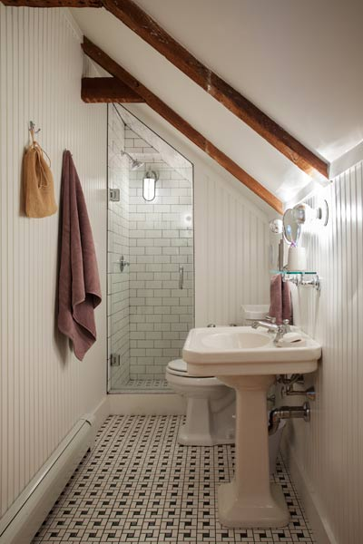 whole house remodel cape cod old restaurant guest bath with tile floor and shower walls, beadboard walls