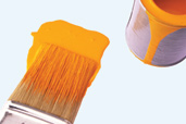 paint brush and paint can with orange paint