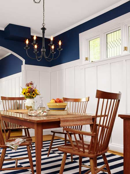 cottage style dining room with board and batten walls and ironwork chandelier, reader budget remodel
