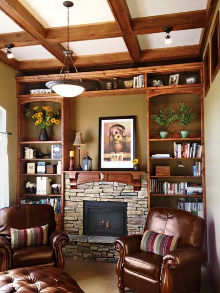 crafstman style living room with bookcases and stone fireplace surround, coffered ceiling, reader budget remodel