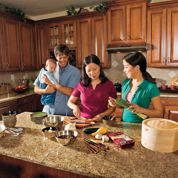 all about stone countertops family in kitchen preparing food