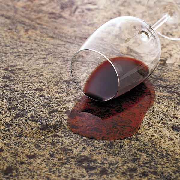 all about stone countertops glass of red wine spilled on stone countertop