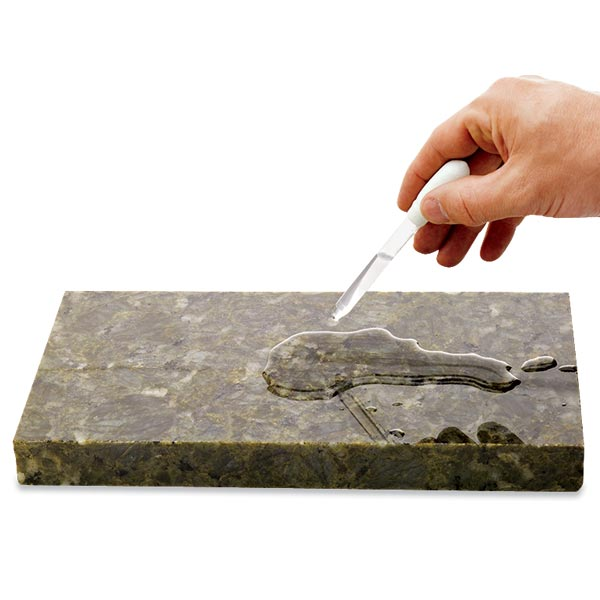 all about stone kitchen countertops person testing countertop surface to see if need for sealing