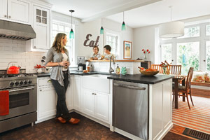 family in open kitchen after remodel
