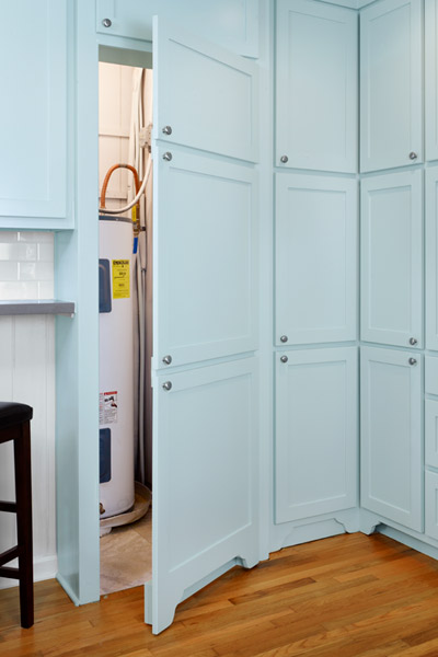 remodel with fake cabinet doors to hide storage area for water heater