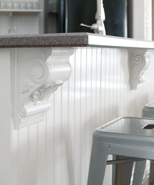 corbels on kitchen island in after budget redo of kitchen