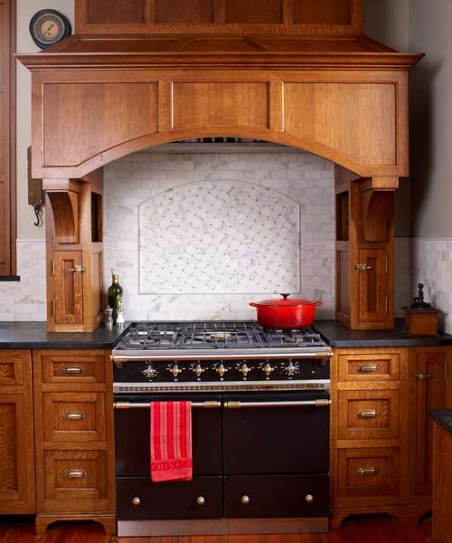 after kitchen remodel with homeowner designed and installed marble range backsplash