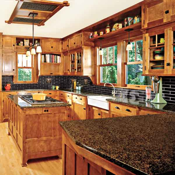 craftsman style kitchen with wood accents, open storage and cabinets up to dead space against ceiling