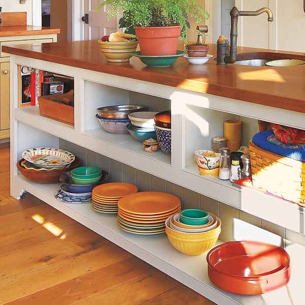 kitchen island with open storage for mixing bowls, dishes