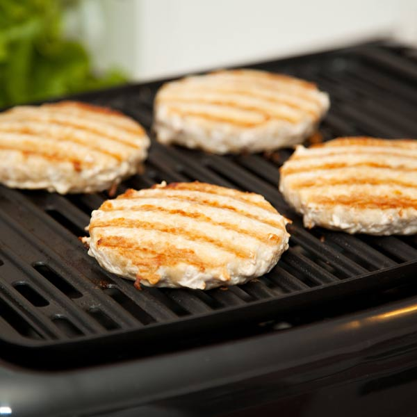 chicken patties grilling on indoor grill