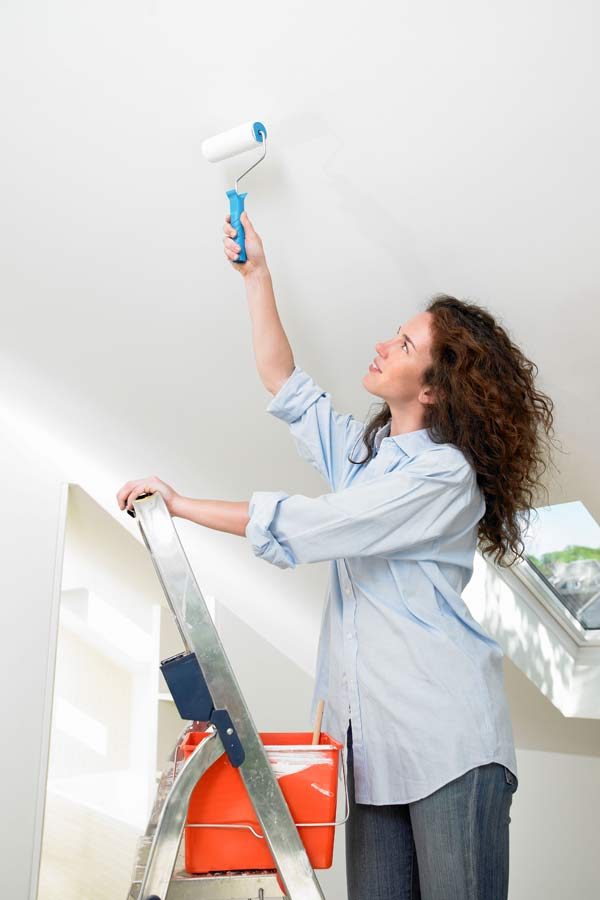 DIY calorie burners woman painting a ceiling