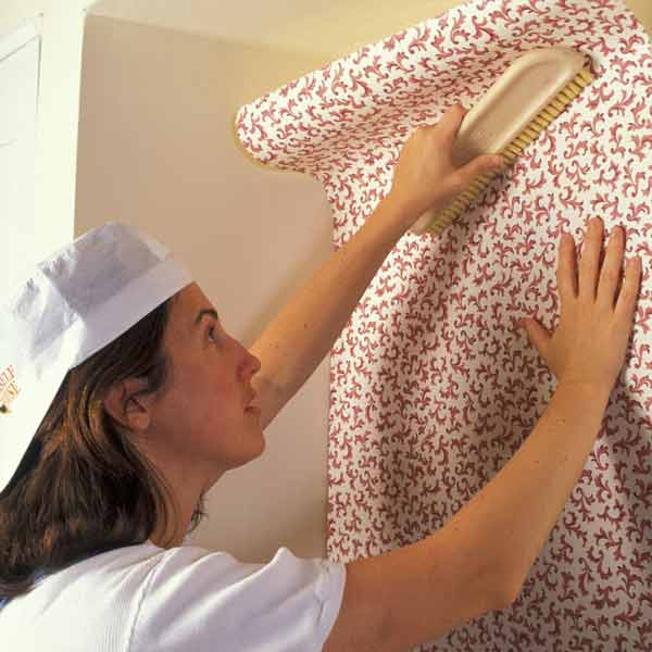 DIY calorie burners woman hanging wallpaper