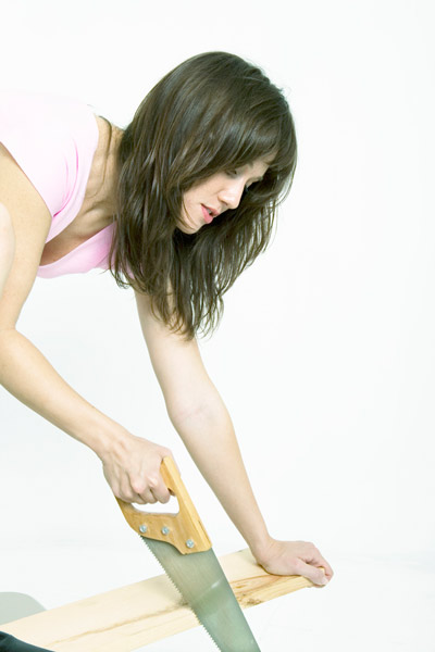 DIY calorie burners woman sawing wood