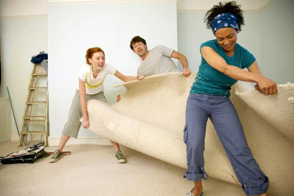 DIY calorie burners women and man ripping up old carpet