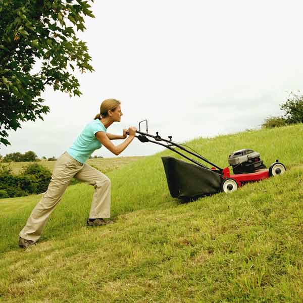 DIY calorie burners woman pushing a lawn mower up a hill