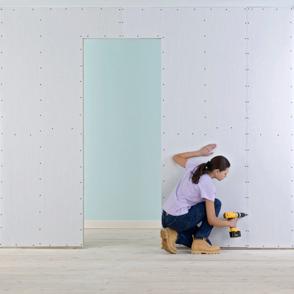 DIY calorie burners woman hanging drywall