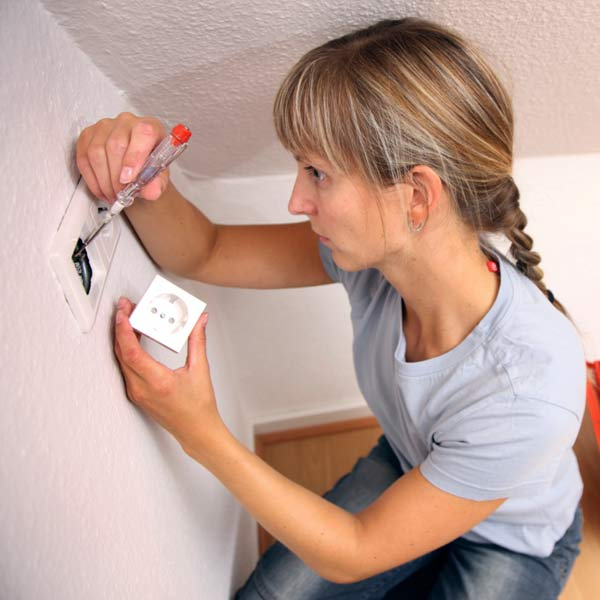 DIY calorie burners woman wiring an electrical outlet