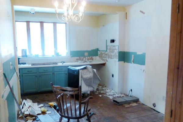 Vintage Schoolhouse Style Before from this old house's Best Kitchen Before and Afters 2013