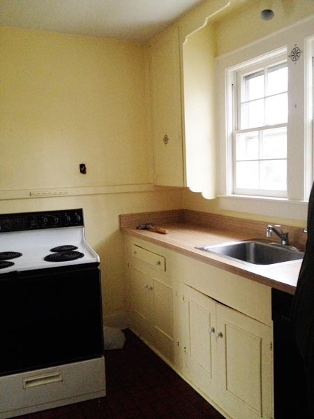 Transforming First House Into Home: Before from this old house's Best Kitchen Before and Afters 2013