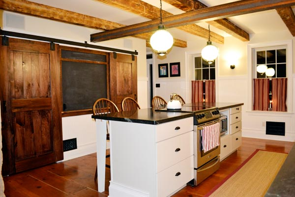 Exposing Ceiling Beams and Using Reclaimed Wood for Rustic Look: After from this old house's Best Kitchen Before and Afters 2013