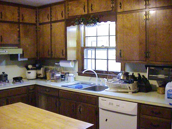 Light and Airy Suspended Cabinets: Before from this old house's Best Kitchen Before and Afters 2013