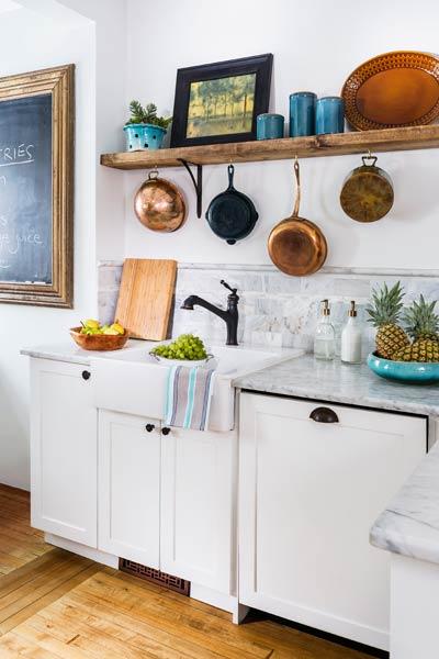 2013 reader remodel contest kitchen winner after remodel with open shelving, pendant lights, tile backsplash, white cabinets, hanging pots and pans on walls, farm sink
