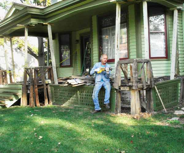 2013 reader remodel contest curb appeal winner during construction, homeowner working on porch