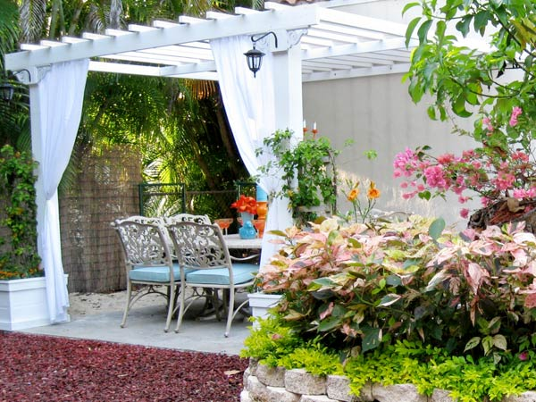 Kristina Steffner's outdoor dining area topped with a pergola in Coral Gables, FL