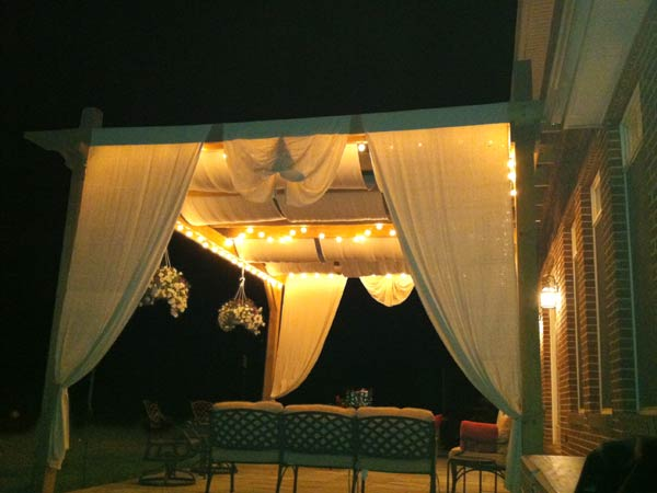 Philip Bishop's pergola lit up for evening entertaining in Pittsburgh, PA