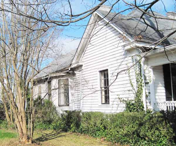 save this old house social circle georgia greek revival cottage exterior view with bay window, original wood siding