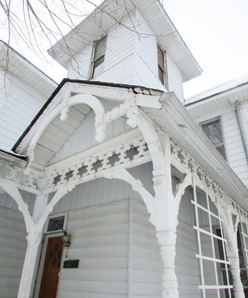 save this old house hope indiana white queen anne exterior with curved porch supports, trusses