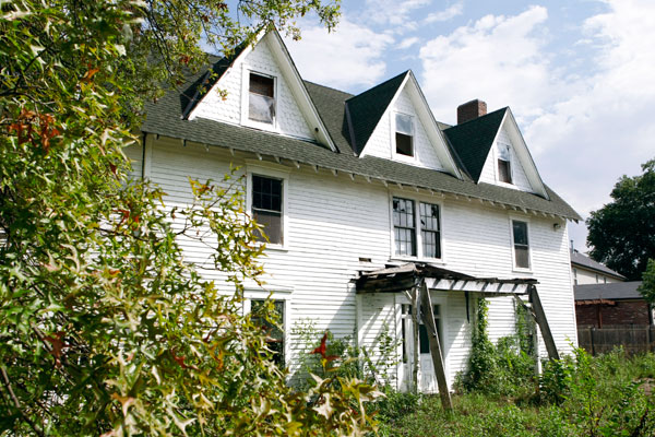 exterior of an 1848 farmhouse for sale in Maplewood, Missouri