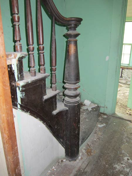 turned newel post and balusters which are original to the home